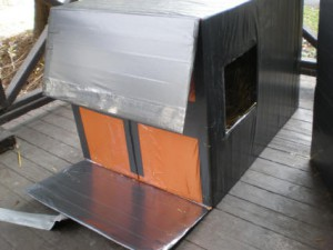 Inner flaps of the resealable end. The polyethylene sheet is covered over with clear packing tape. The strip of duct tape holding the flaps shut can easily be peeled off of the packing tape without causing any damage to the camping sheet.
