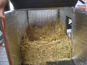 Don't be shy about using the straw, you can load a lot of straw into the box! It gives the kitties more warmth to nest into.